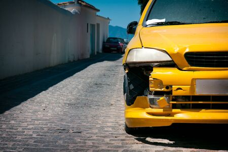wrecked: Car damage, yellow bumper wrecked