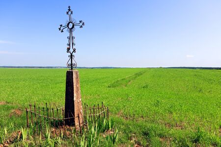the sermon: Holy Cross in a field of grass