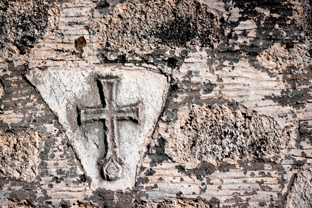 Christian cross on a wall background Stock Photo