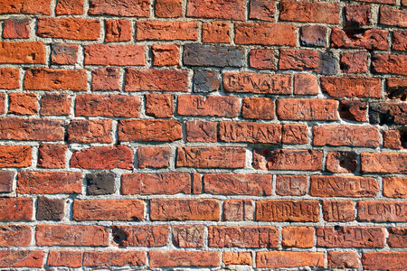 inscriptions: Brick wall with inscriptions Stock Photo