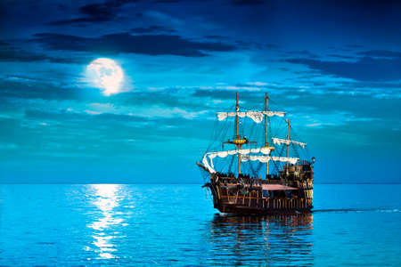 Pirate ship sailing in the moonlight photo