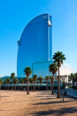 Barcelona beach and the blue  W  hotel skyscraper