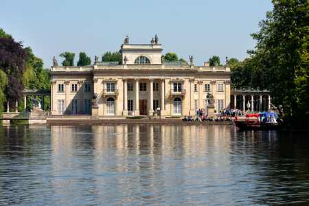 lazienki: Tourists visiting Palace on the Water in Lazienki Park  Royal Baths Park  in Warsaw