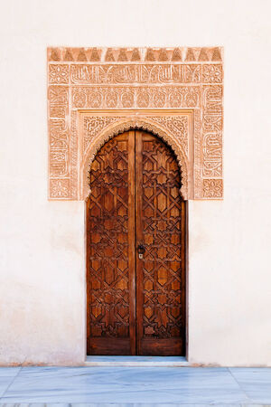 Ancient door decorated with stucco Stock Photo