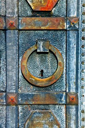 key hole shape: Iron rusty door with a key hole