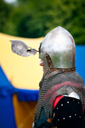 reenactor: Medieval Knight profile with  helmets visor shown open Editorial