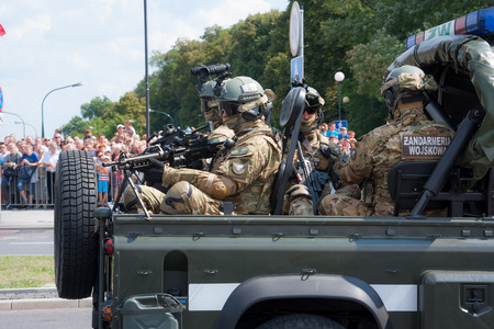 police unit: WARSAW, POLAND - AUGUST 15, 2014: Polish Military Police during the Polish Armed Forces Day parade. Over 1200 Polish and over 90 foreign soldiers, over 120 military vehicles, more than 50 aircrafts Editorial