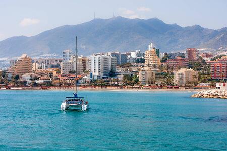 Benalmadena City view, sailing catamaran Editorial