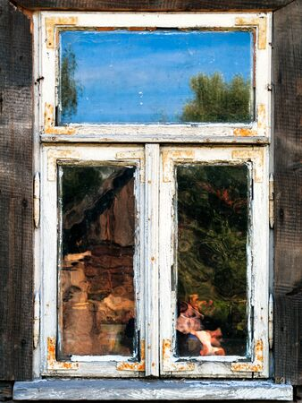 mirror on wall: Old wooden window and blurry reflections