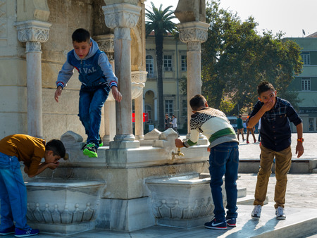 Izmir, Turkey, the young generation at the Clock Tower Stock Photo - 38184072