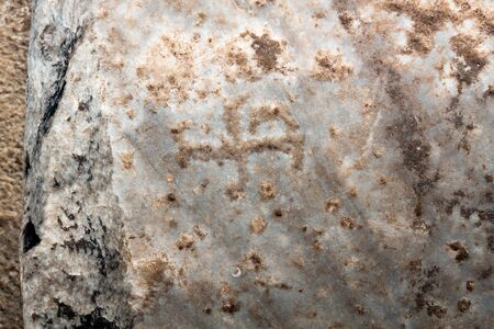 Ancient background stone carved cross