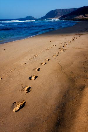 praia: Foot steps in the sand, beach Praia Grande on Sao Vicente Island