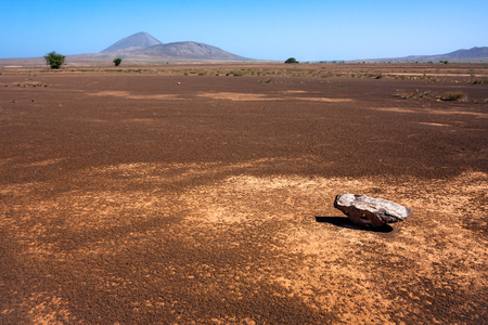 Single rock in the desert of Sal Island, Cape Verde Stock Photo