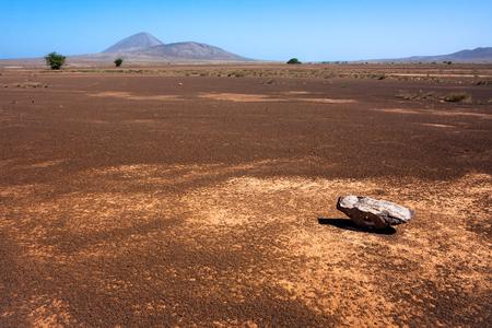 desert island: Single rock in the desert of Sal Island, Cape Verde Stock Photo