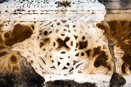 Floral pattern carved in stone wall Stock Photo
