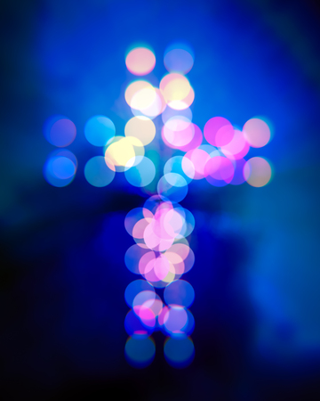 redemption: Christian cross bokeh blurry lights Stock Photo