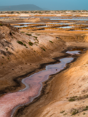 Sandy landscape of salt mine water ponds in Santa Maria, Cape Verde Stock Photo