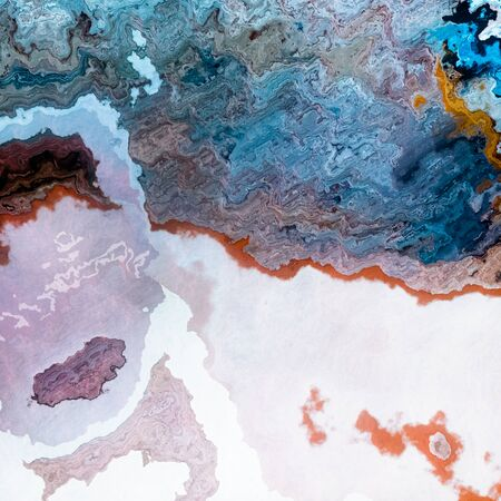 Mineral layers of blue coffe and milk mixture. Abstract background Stock Photo