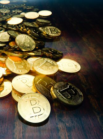 Physical Bitcoin money scattered on table