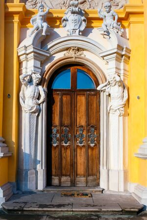 Richly ornamented door with cupids and atlants at the baroque Wilanow Royal Palace