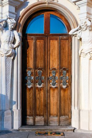 Door with atlants at the baroque Wilanow Royal Palace Editorial