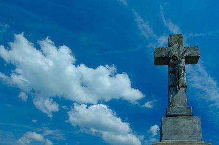 overhang: stone cross on sky