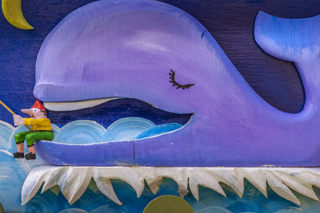A wooden whale with Pinocchio Stockfoto