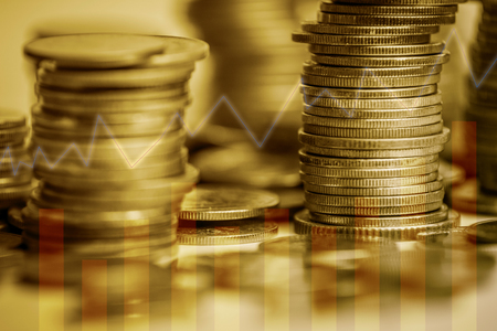 Stack of coins stock financial indices on currency exchange. Financial stock market in accounting market economy analysis. Digital stock exchange trade cost background. Economy financial cost concept; Stock Photo