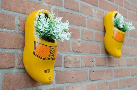 wooden shoes: Dutch wooden shoes hanging on the wall
