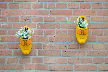 Dutch wooden shoes hanging on the wall