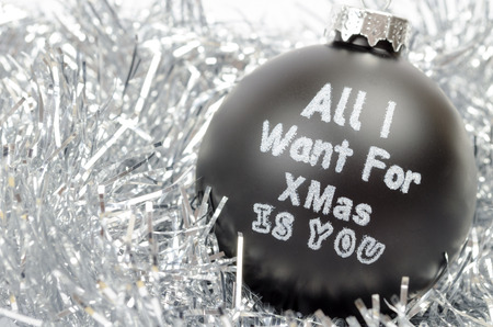 White and black crhistmas ball - all i want for christmas is you Stock Photo