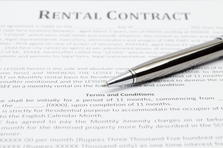 Rental contract with grey pen