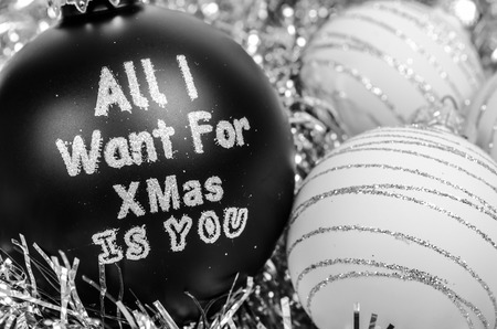 White and black crhistmas balls - all i want for christmas is you Stock Photo