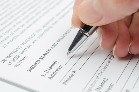 Female hand filling a document with personal data Stock Photo