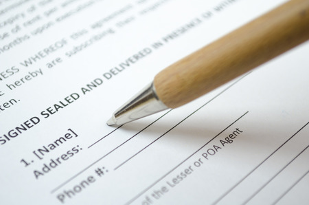 legal services: Filling personal data with wooden pen Stock Photo