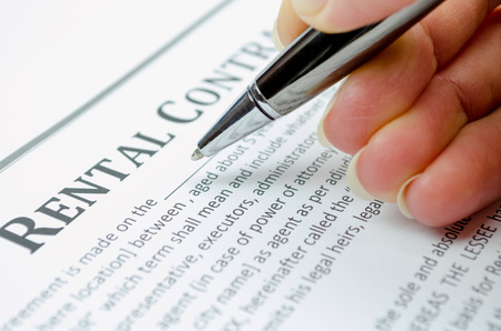Female hand filling rental contract Stock Photo