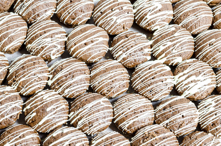 Brown cookies with white chocolate stripes Stock Photo