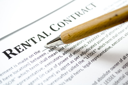Filling a rental contract 스톡 콘텐츠
