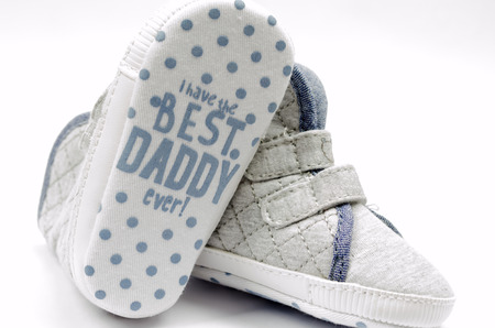 ecoration: Baby shoes best daddy ever Stock Photo