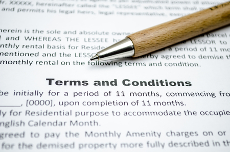 Terms and conditions with wooden pen