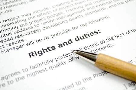 Rights and duties with wooden pen Stock Photo