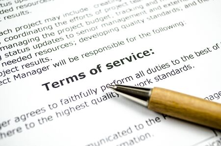 Terms of service with wooden pen 스톡 콘텐츠