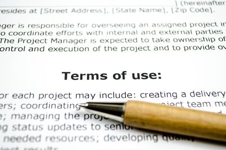 Terms of use with wooden pen