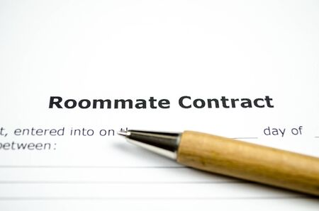 Roommate contract with wooden pen