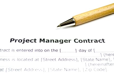 Project manager contract with wooden pen Stock Photo
