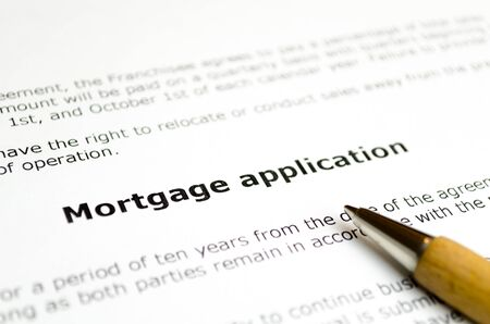 Mortgage application with wooden pen