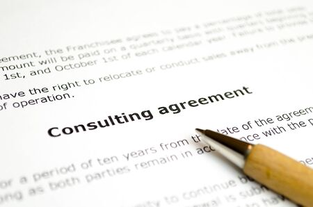 Consulting agreement with wooden pen Stock Photo