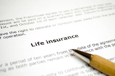 Life insurance with wooden pen Stock Photo