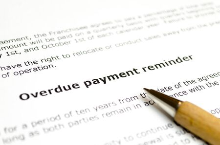 Overdue payment reminder with wooden pen Stock Photo
