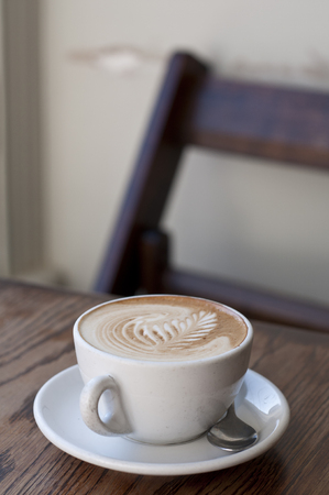 Fern motif on top of coffee in a cafe Stock Photo